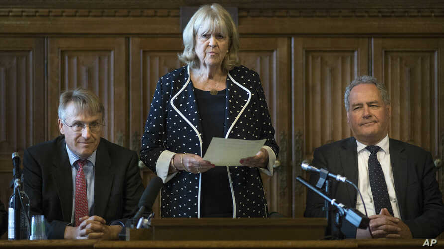 Dame Cheryl Gillan with Charles Walker (L) and Bob Blackman (R) read out the results of the first ballot in the Tory leadership ballot at the Houses of Parliament in Westminster, London, June 13, 2019.