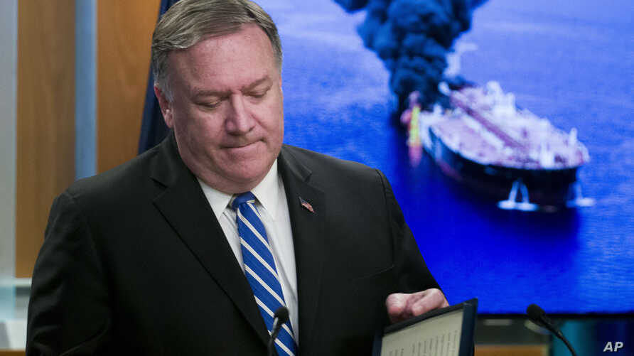 Secretary of State Mike Pompeo closes his remarks as he departs after a media availability, at the State Department, June 13, 2019.