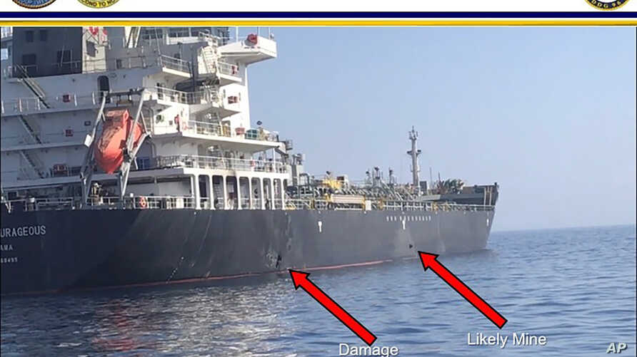 This June 13, 2019, image released by the U.S. military's Central Command, shows damage and a suspected mine on the Kokuka Courageous in the Gulf of Oman near the coast of Iran.