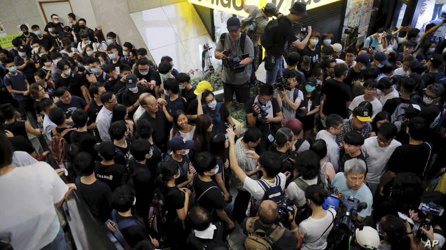 Protesters attempt to block the lobby of the Hong Kong Revenue Tower in Hong Kong on June 24, 2019.