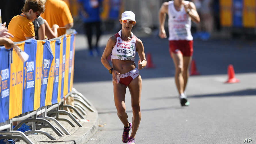 FILE - Portugal's Ines Henriques competes in the women's 50-kilometer race walk at the European Athletics Championships in Berlin, Germany, Aug. 7, 2018.