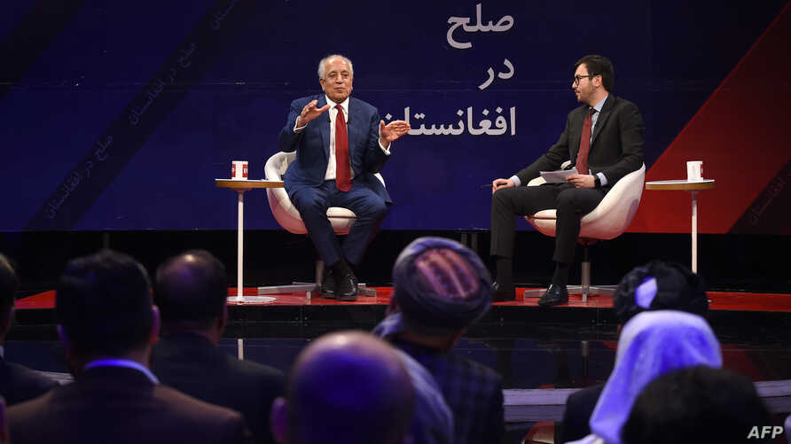 U.S. special representative for Afghan peace and reconciliation Zalmay Khalilzad, left, gestures as he speaks during a forum with Afghan director of TOLO news Lotfullah Najafizada at the Tolo TV station in Kabul, April 28, 2019.