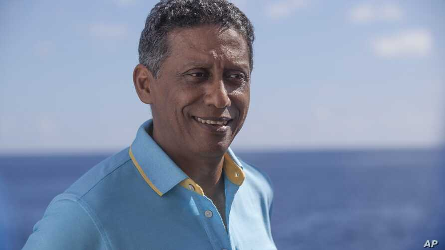 Seychelles President Danny Faure smiles during an interview with the Associated Press, on board the vessel Ocean Zephyr off the coast of Desroches, in the outer islands of Seychelles, April 13, 2019.