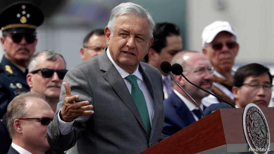 Mexico's President Andres Manuel Lopez Obrador gives a speech during the inauguration of the Aerospace Fair 2019 at the Santa Lucia military airbase in Tecamac near Mexico City, April 24, 2019.