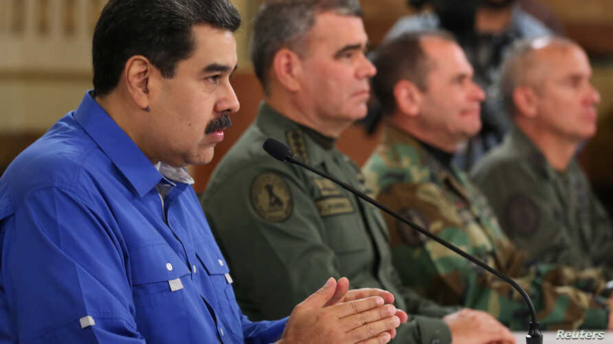 Venezuela's President Nicolas Maduro speaks during a broadcast with members of the government and military high command members at Miraflores Palace in Caracas, Apr. 30, 2019. (Miraflores Palace handout via Reuters)