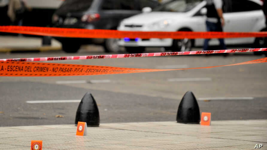 Evidence tent markers mark the crime scene where Argentine lawmaker Hector Olivares was seriously injured and another man was killed after they were shot at from a parked car near the Congress building in Buenos Aires, Argentina, May 9, 2019