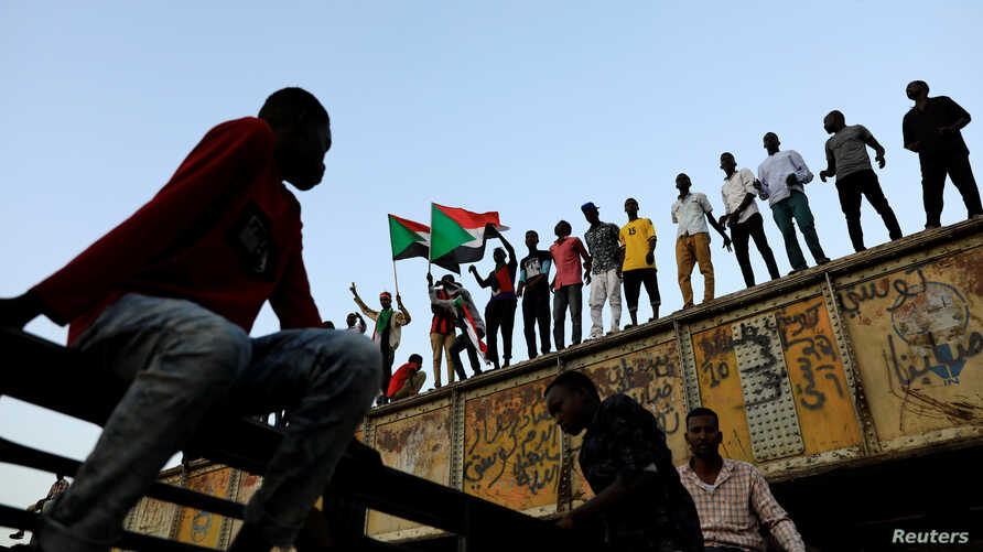 FILE - Sudanese protesters rally in front of army headquarters in Khartoum, Sudan, May 6, 2019.