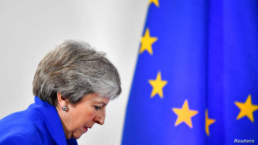 FILE - Britain's Prime Minister Theresa May arrives for a news conference in Brussels, Belgium, Nov. 25, 2018.