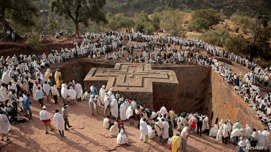 Ethiopian Orthodox pilgrims attend a prayer session at the monolithic Orthodox church ahead of Ethiopian Christmas in Lalibela, Ethiopia Jan. 6, 2018.