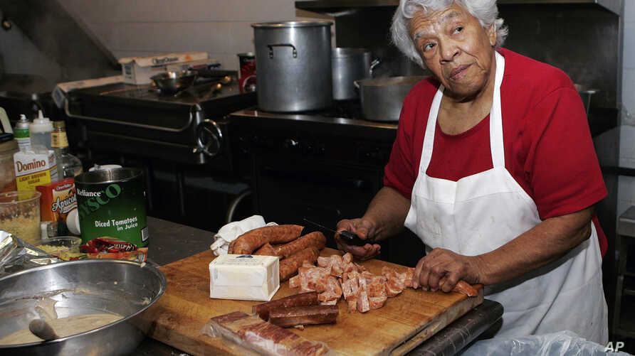 FILE - Chef Leah Chase, owner of Dooky Chase, prepares lunch at her restaurant in New Orleans, Louisiana, Jan. 20, 2009.