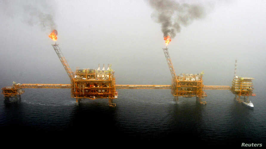 FILE PHOTO: Gas flares from an oil production platform at the Soroush oil fields in the Persian Gulf, south of the Iranian capital in Tehran, July 25, 2005.