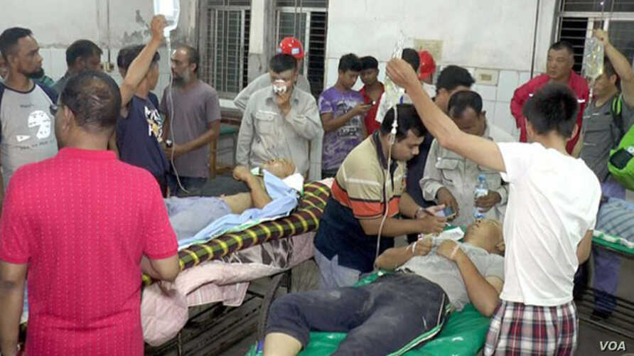 Chinese power plant workers injured in a fight with Bangladeshi work mates are treated at Sher-e-Bangla Medical College Hospital in Barisal, Bangladesh,