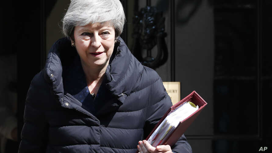 Britain's Prime Minister Theresa May leaves 10 Downing Street for the House of Commons for her weekly Prime Minister's questions in London, May 1, 2019.