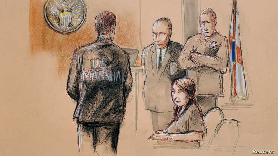 FILE - Yujing Zhang, charged with bluffing her way into President Donald Trump's Florida resort, is seated upon arrival with U.S. Marshals, awaiting the start of her hearing, at the U.S. federal court, in this courtroom sketch, in West Palm Beach, Fl...