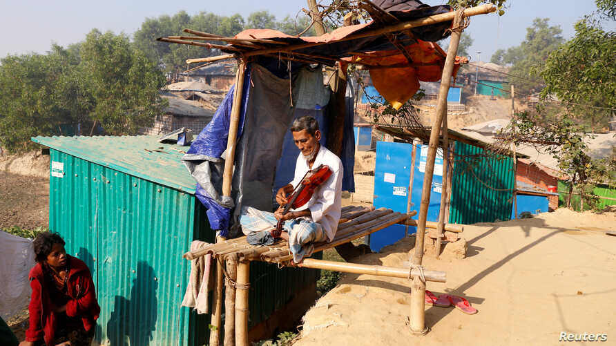 FILE PHOTO: Amir Ali, 75, plays a violin in front of his house in Kutuapalong Rohigya refugee camp in Cox's Bazar, Bangladesh, Feb. 8, 2019.