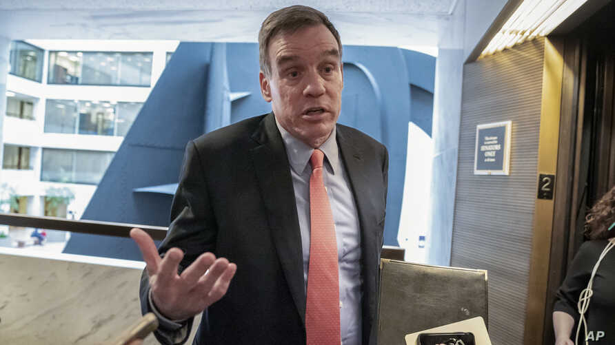Senate Intelligence Committee Vice Chair Mark Warner, D-Va., who leads the panel with Republican Chairman Richard Burr of North Carolina, departs after a meeting at committee's secure facility on Capitol Hill in Washington, May 9, 2019.
