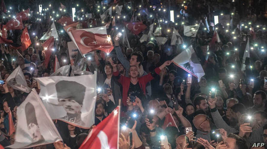 Supporters of Istanbul Mayor Ekrem Imamoglu wave flags as they take part in a protest against the re-run of the Istanbul mayoral election in Istanbul, May 6, 2019.