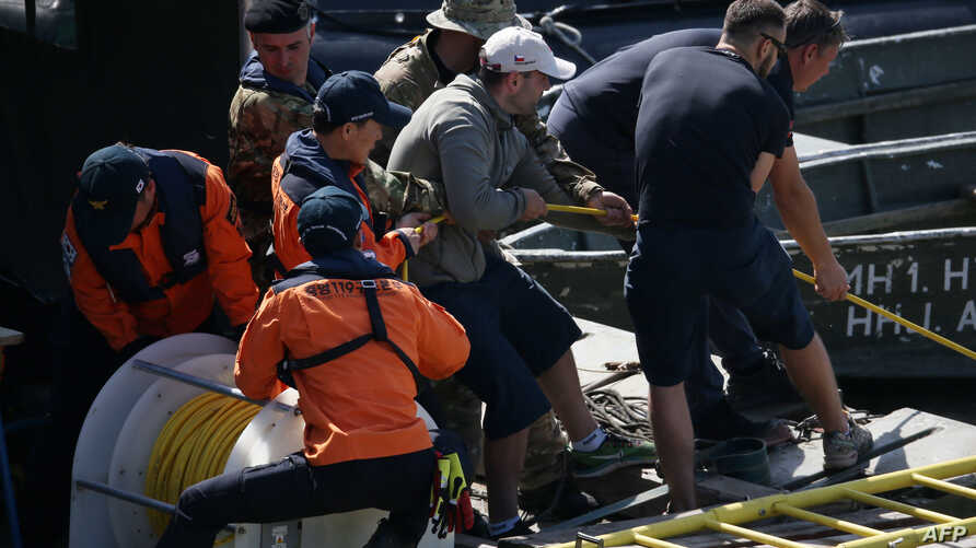 Local and South Korean experts work on a boat during the search for survivors at the site of a boat accident on the Danube river, June 1, 2019, in Budapest. The work has been hampered by high river levels and a strong current after weeks of heavy rai...