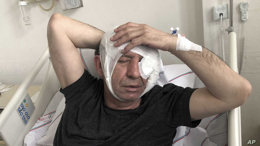 Yavuz Selim Demirag, a Turkish journalist critical of President Recep Tayyip Erdogan's government and its nationalist allies, rests in a hospital bed in Ankara, May 11, 2019. The Yenicag newspaper said Demirag was beaten by a group after appearing on...