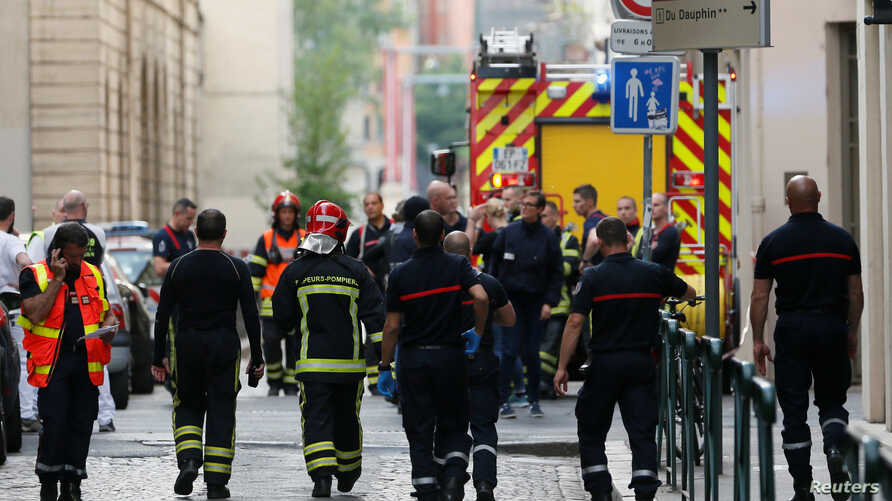 Firefighters and medics are seen near the site of an explosion in central Lyon, France, May 24, 2019.