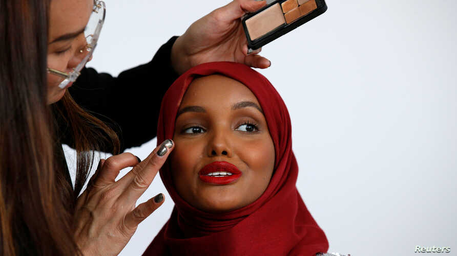 Fashion model and former refugee Halima Aden, has her makeup applied during a shoot at a studio in New York City, U.S. August 28, 2017.