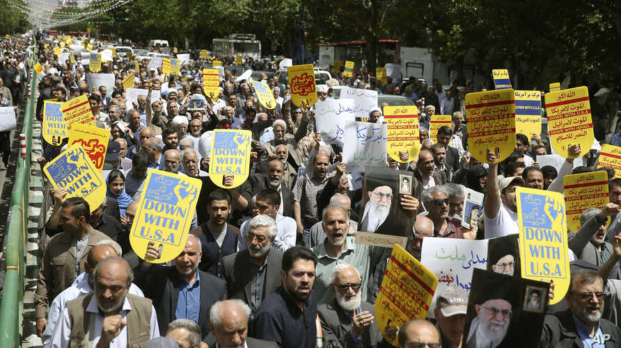 Worshippers chant slogans against the United States and Israel during a rally after Friday prayers in Tehran, Iran, May 10, 2019.