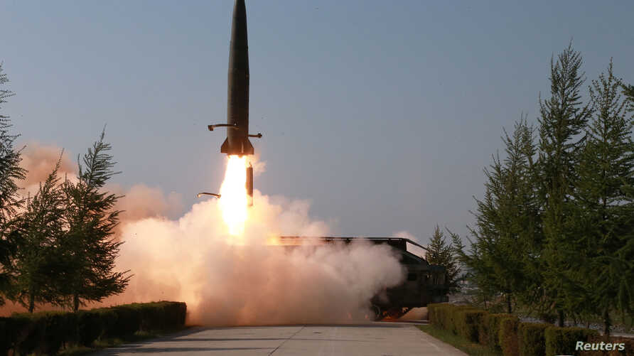 A missile is seen launched during a military drill in North Korea, in this May 10, 2019 photo supplied by the Korean Central News Agency (KCNA).