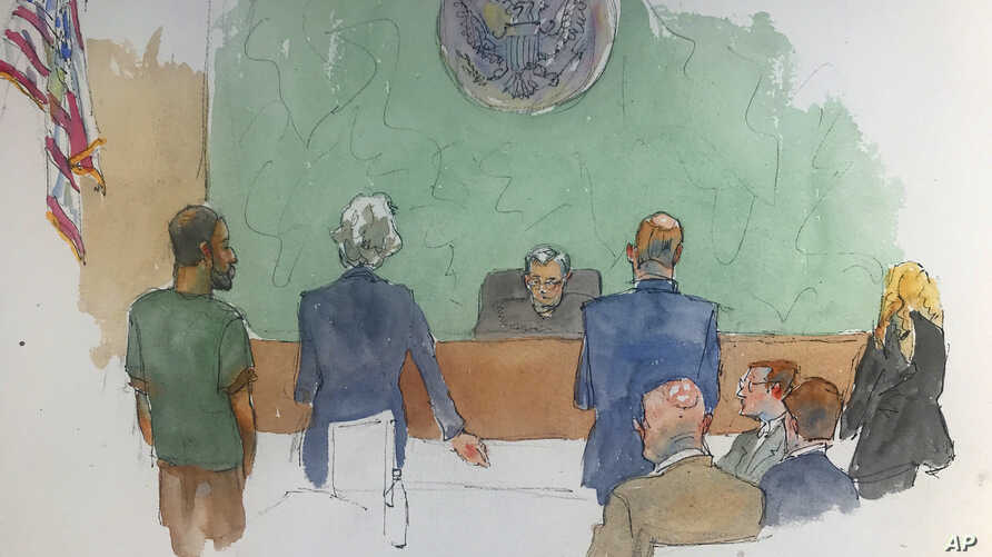 In this courtroom drawing, Najibullah Zazi, left, appears at federal court in Brooklyn, New York, May 2, 2019, where he was sentenced to 10 years in prison for plotting to bomb the New York subway system in 2009.