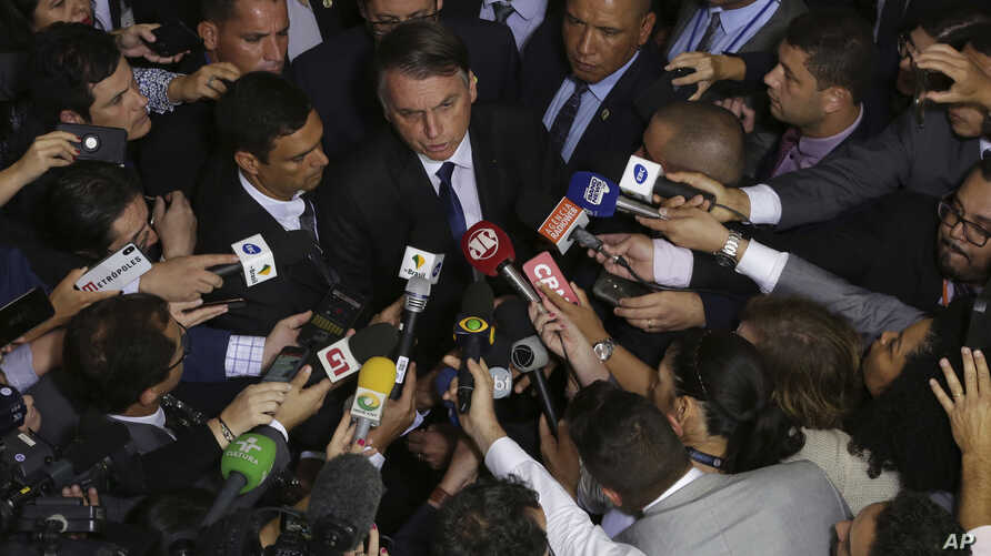 Brazil's President Jair Bolsonaro speaks to the press after signing a second decree that eases gun restrictions, at the Planalto presidential palace in Brasilia, Brazil, May 7, 2019.