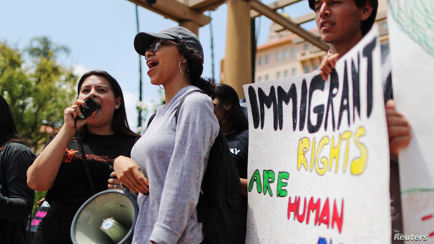 FILE - Protestors demonstrate against the termination of the Deferred Action for Childhood Arrivals (DACA) program outside the 9th Circuit Court of Appeals in Pasadena, California, U.S., May 15, 2018.