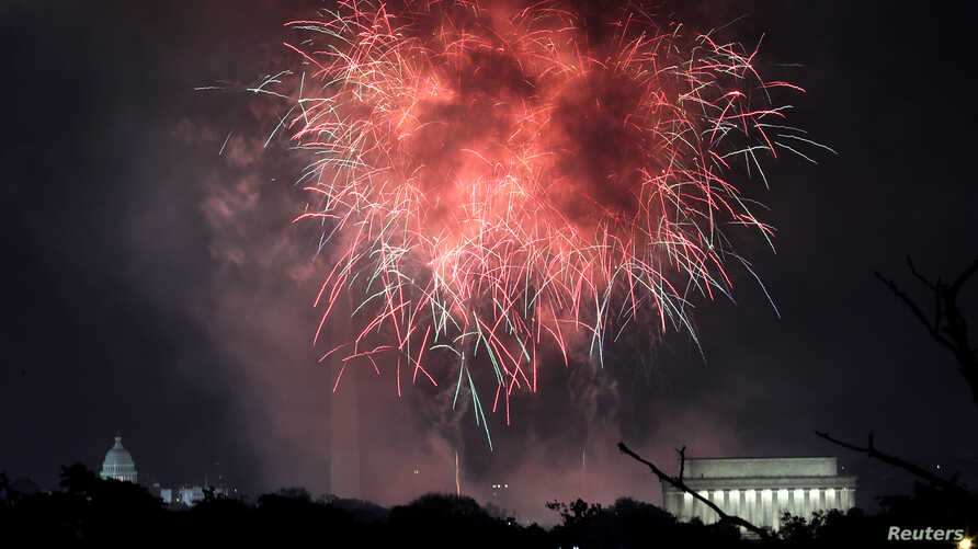 FILE - Fireworks explode over the U.S. Capitol (L), the Washington Monument (C) and the Lincoln Memorial (R) in celebration of the 241st anniversary of the Declaration of Independence and the 4th of July holiday in Washington, July 4, 2017.