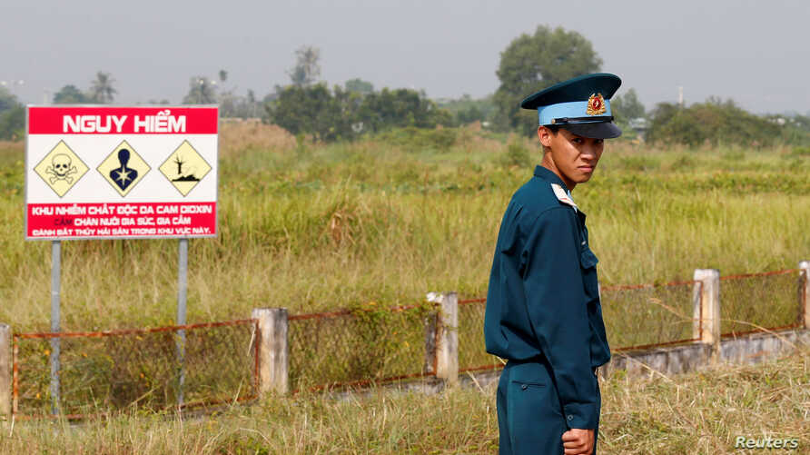 FILE - A Vietnamese soldier stands guard at the dioxin-contaminated area near Bien Hoa airbase, where the U.S. Army stored the defoliant Agent Orange during the Vietnam War, in Bien Hoa city, outside Ho Chi Minh City, Vietnam, October 17, 2018.