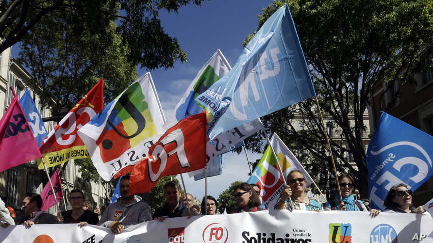 Public sector workers hold unions flags during a demonstration in Marseilles, southern France, May 9, 2019.