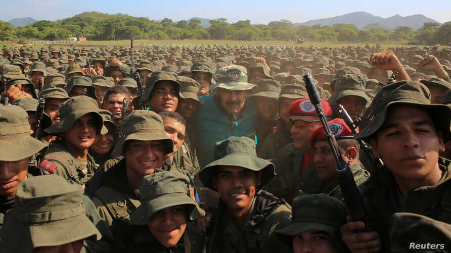 Venezuela's President Nicolas Maduro poses for a photo with soldiers during his visit to a military training center in El Pao, Venezuela, May 4, 2019.