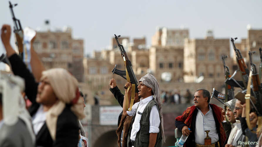 FILE - Houthi supporters attend a rally to mark the first anniversary of the killing of Saleh al-Sammad, who was the head of the Houthi movement's Supreme Political Council, in an airstrike, in Sanaa, Yemen, April 19, 2019.