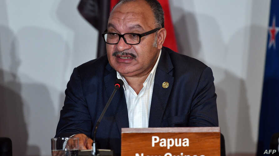 FILE - Papua New Guinea's Prime Minister Peter O'Neill speaks at an electricity projects signing ceremony, Nov. 18, 2018, during the Asia-Pacific Economic Cooperation (APEC) Summit in Port Moresby.