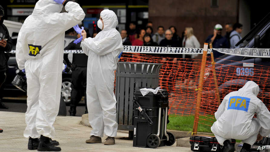 Police collect evidence at the crime scene where Argentine lawmaker Hector Olivares was seriously injured and another man was killed after they were shot at from a parked car near the Congress building in Buenos Aires, Argentina, May 9, 2019.