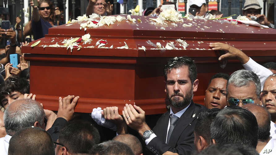 Alan Raul Garcia, son of Peru's late President Alan Garcia, carries the coffin of his father during the funeral procession in Lima, Peru, April 19, 2019.