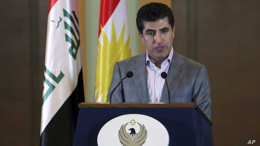 FILE - Nechirvan Barzani, then-prime minister of Iraq's Kurdistan regional government, speaks to media during a regional election in Irbil, Sept. 21, 2013.