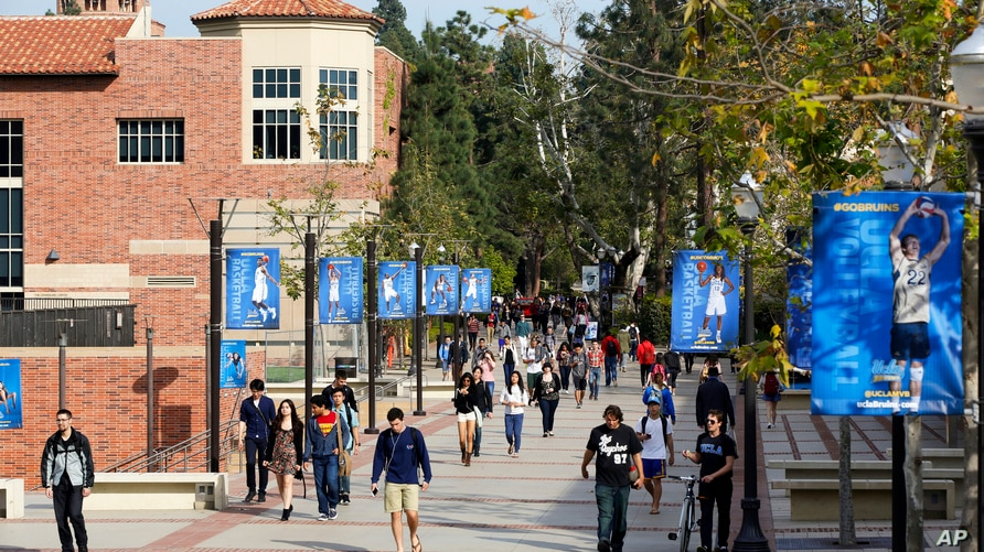 FILE - Students on the University of California, Los Angeles campus, Feb. 26, 2015.