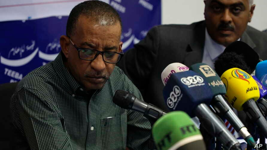 Sudanese civil society activist Omer Eldigair, left, one of the leaders from the protest movement, gives a press conference in the capital Khartoum, April 24, 2019.