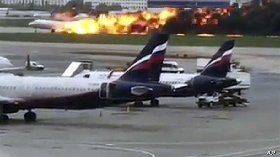 This image taken from video provided by Instagram user @artempetrovich, shows the SSJ-100 aircraft of Aeroflot Airlines on fire during an emergency landing in Sheremetyevo airport in Moscow, Russia, May 5, 2019.