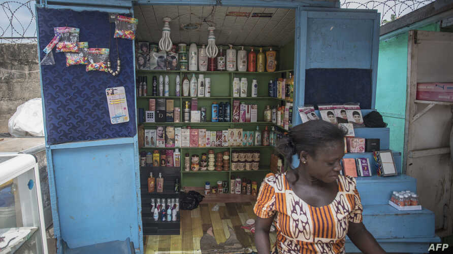 A shop sells skin-lightening products in Accra, Ghana, July 3, 2018. Africa is experiencing a massive trend of skin bleaching, also called lightening or whitening, particularly in teenagers and young adults. The widening phenomenon is laden with heal...