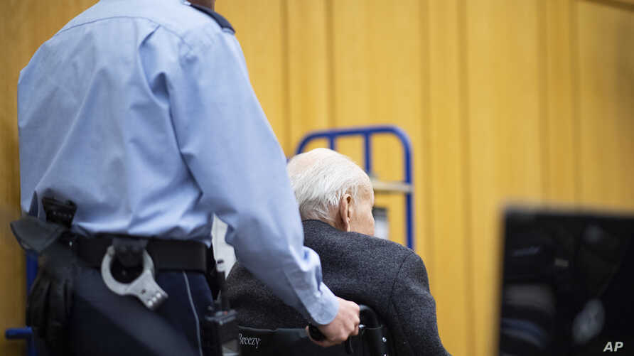 FILE - Johann Rehbogen, a 94-year-old former SS enlisted man, accused of hundreds of counts of accessory to murder for alleged crimes during his years as a guard at the Nazis' Stutthof concentration camp, arrives in a wheelchair for the third day o...
