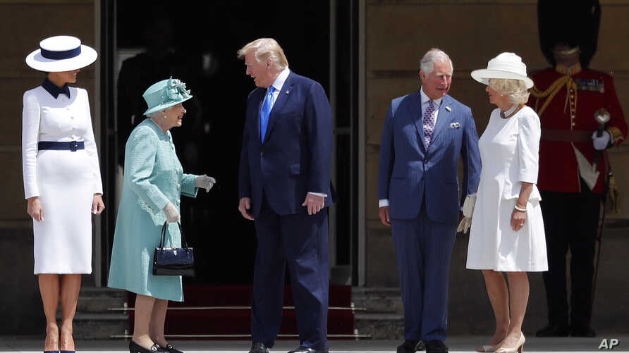 Britain's Queen Elizabeth II greets President Donald Trump, center, and first lady Melania Trump, left, with Britain's Prince Charles and Camilla, Duchess of Cornwall during a ceremonial welcome in the garden of Buckingham Palace in London, June 3, 2...