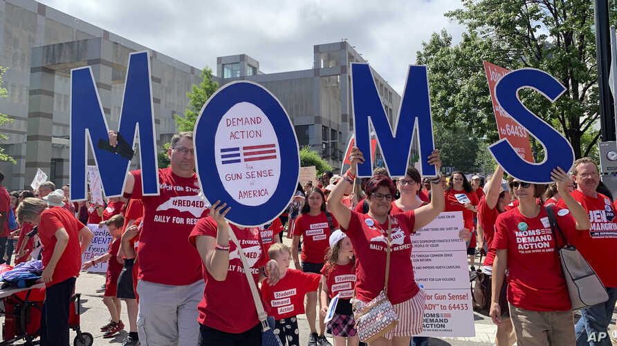 Members of Moms Demand Action march in support of teachers, May 1, 2019, during a teacher rally, in Raleigh, North Carolina.