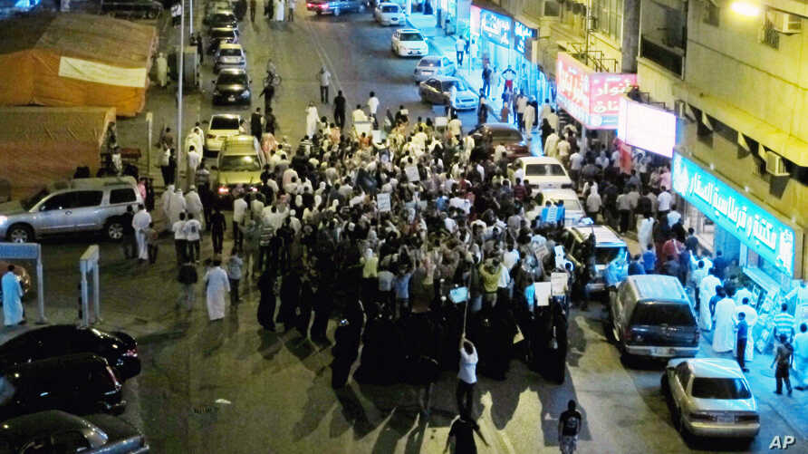 FILE - In this March 10, 2011, photo, Saudi Shiites protest in Qatif, Saudi Arabia. A Saudi dissident in Washington said the execution of 37 people in Saudi Arabia on April 23, 2019, most of whom were Shiite Muslims, was a political message aimed at ...