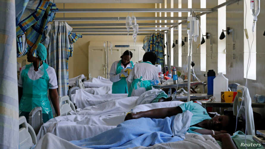 FILE - Medical practitioners attend to a cholera patient inside a special ward at the Kenyatta National Hospital in Nairobi, Kenya, July 19, 2017.