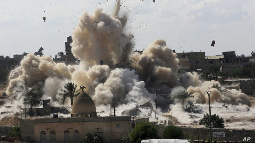 FILE - Smoke rises after Egyptian army demolished houses on the Egyptian side on border town of Rafah, Oct. 29, 2014.