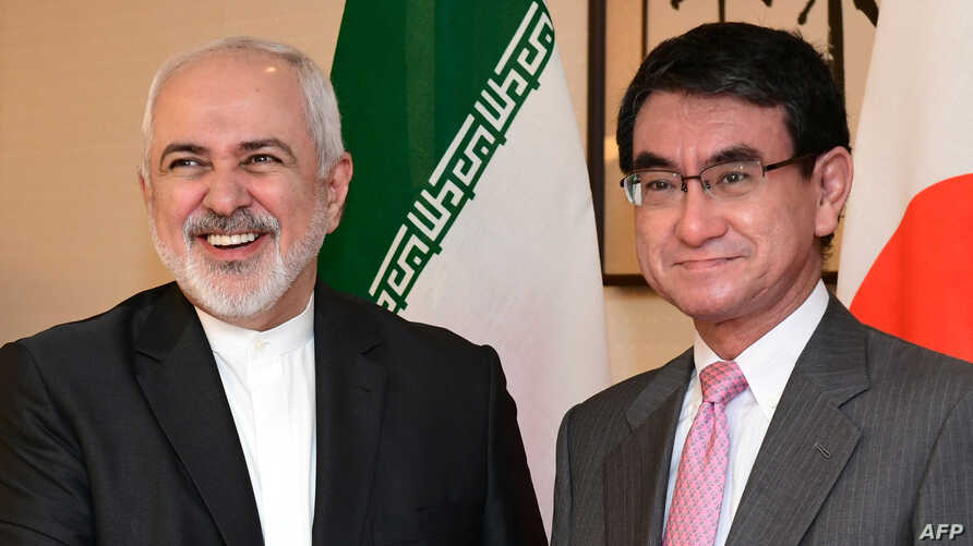 Iranian Foreign Minister Mohammad Javad Zarif, left, and his Japanese counterpart Taro Kono pose for the media before their talks at the foreign minister's audience room in Tokyo, May 16, 2019.